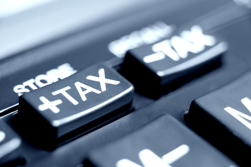 How is business income taxed?